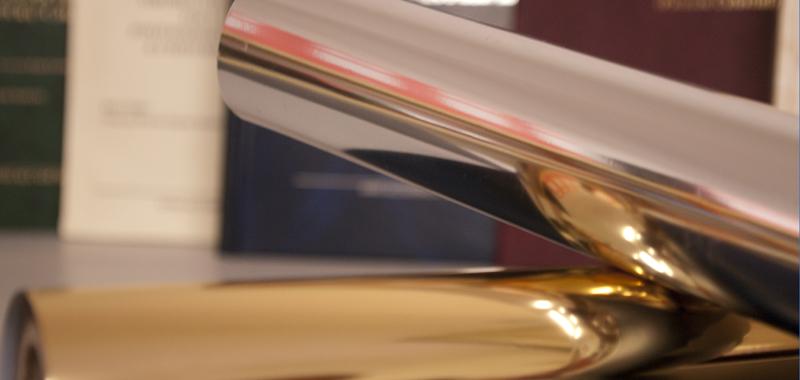 fronte spizio tesi oro e argento